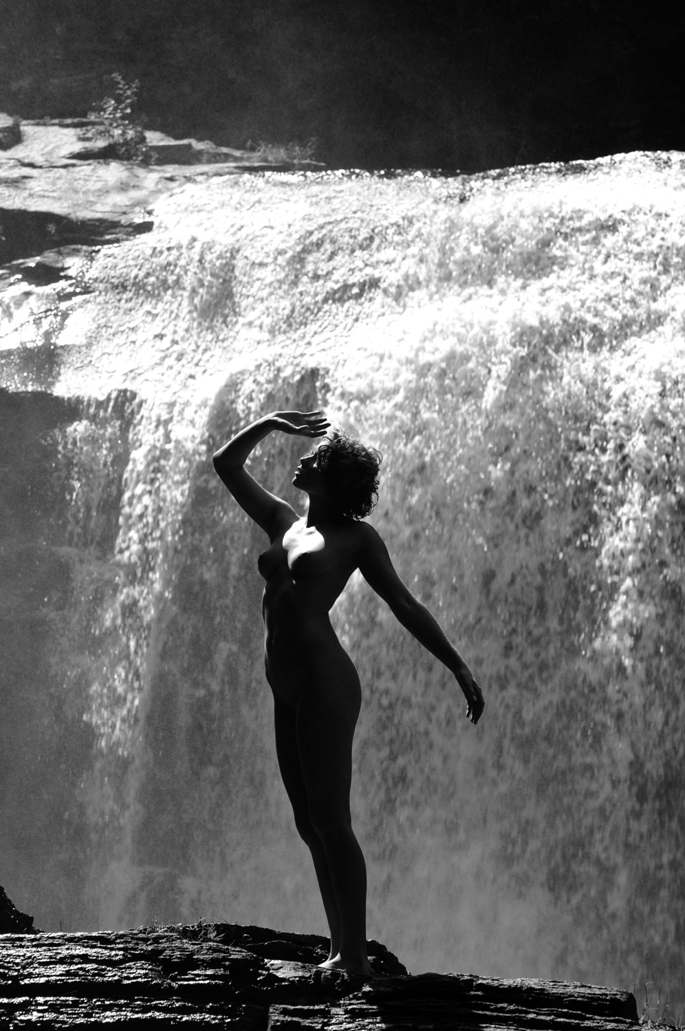 Nude silhouette by waterfall