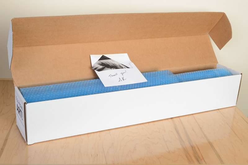 Archival photographs are double-packed and shipped insured