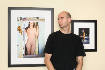 Artist with photographs