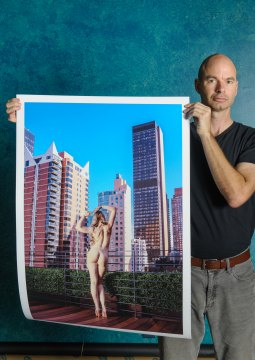 Artist with artwork. Nude photograph Midtown Manhattan New York City. Limited edition signed/numbered