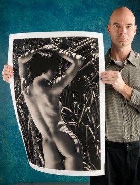 Art photographer A K Nicholas with artwork. One blue fingernail.