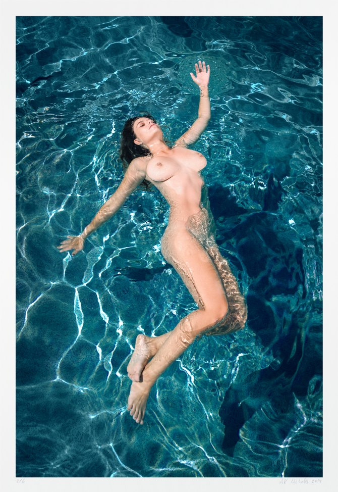 Contemporary figure photography of a nude woman swimming. Limited edition art.