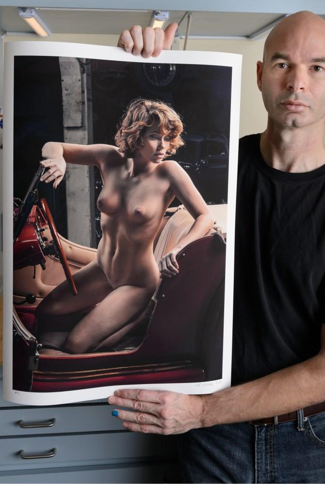 artist with artwork, photograph