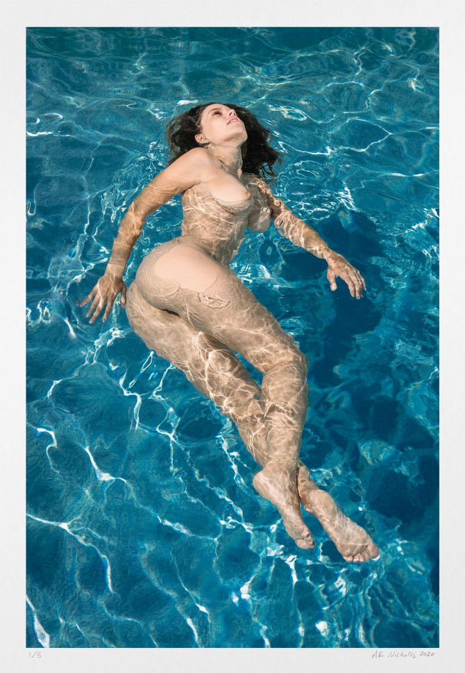 Artistic erotic photography: limited edition swimming nude woman