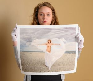 Model holding artwork